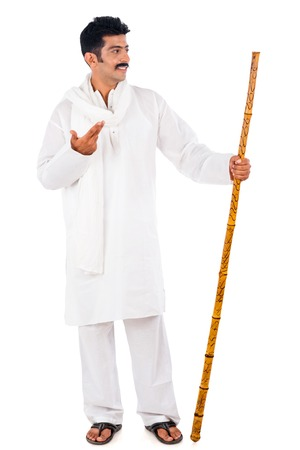 kurta: Man holding a wooden staff and gesturing Stock Photo