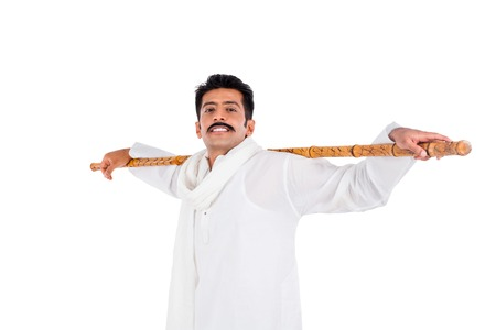 kurta: Portrait of a man keeping wooden staff on his shoulders