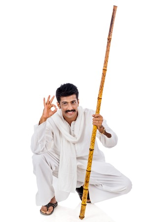 kurta: Portrait of a man holding wooden staff and gesturing