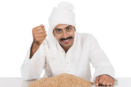 kurta: Portrait of a man holding wheat in his hand