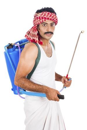 dhoti: Portrait of a farmer carrying crop sprayer