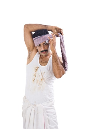 dhoti: Portrait of a farmer wrapping cloth on his head Stock Photo