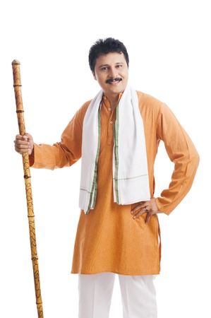 Portrait of a man holding wooden staff and smiling