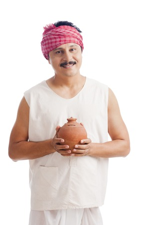 Portrait of a farmer holding a piggy bank and smiling photo