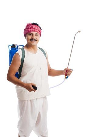 crop sprayer: Portrait of a farmer carrying crop sprayer