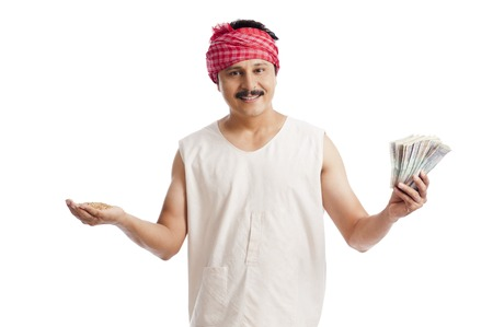 Portrait of a farmer holding money in one hand and wheat in another hand photo