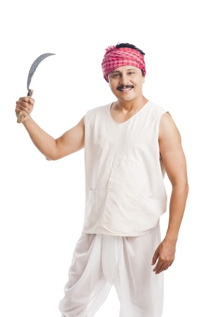 dhoti: Portrait of a farmer holding a sickle and smiling Stock Photo