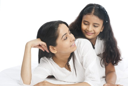 indian happy family: Close-up of a woman and her daughter smiling Stock Photo