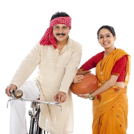 Portrait of a couple with bicycle Фото со стока