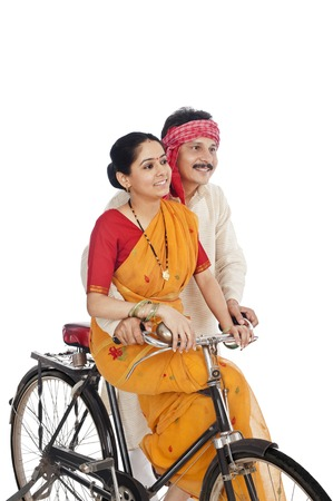 Couple riding a bicycle photo