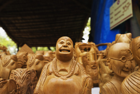 buddha image: Statues of Laughing Buddha for sale at souvenir shop Stock Photo
