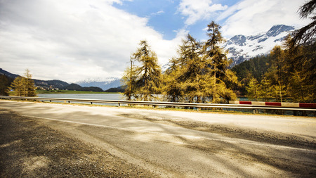 Road at lakeside in the valley, St. Moritz, Italy Stok Fotoğraf