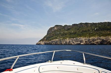 Boat in the sea with cliff, Capri, Naples Province, Campania, Italy Standard-Bild