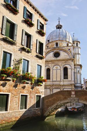Bridge over a canal with a church , Venice, Veneto, Italy