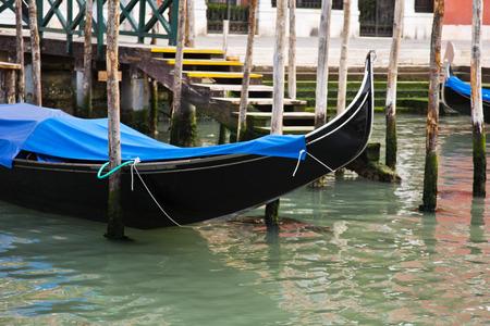 Gondola anchored in a canal, Venice, Veneto, Italy Standard-Bild