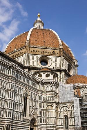 Cathedral in a city, Duomo Santa Maria Del Fiore, Piazza Del Duomo, Florence, Tuscany, Italy photo