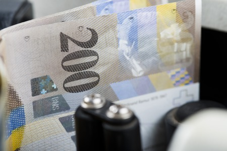 counted: Two Hundred Euro notes being counted in a machine Stock Photo