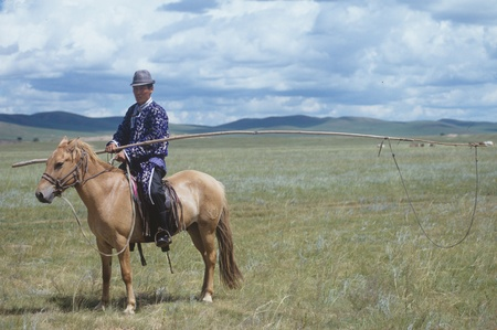 Herders riding horse