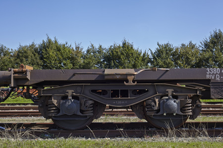 axle: Bogie of a freight wagon with frame, coil springs, wheels and axle bearings