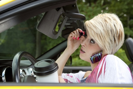 woman driving car: Barbie distracted while driving