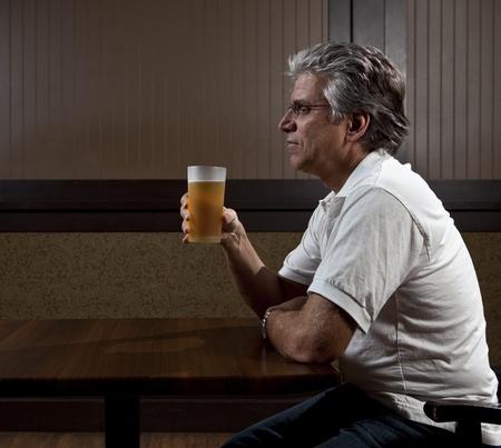 drunk man: Man drinking alone Stock Photo