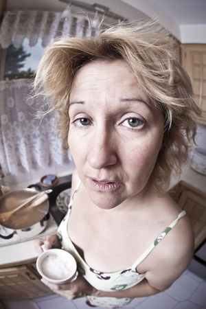 unkempt: Woman waking up with a coffee (Dirty dishes fisheye)  Stock Photo