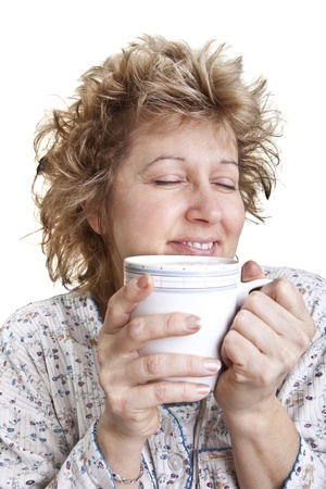 bedhead: Woman waking up with a coffee