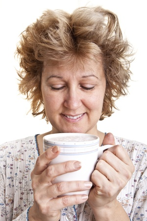 bedhead: Woman waking up with a coffee (Looking at coffee)  Stock Photo