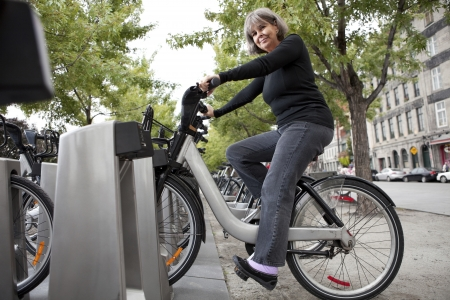 Woman on a public bicycle  Editorial
