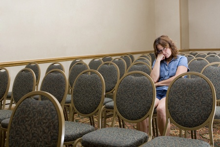 distracted: Woman at a boring conference  Stock Photo