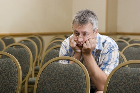 bore: Man at  a boring conference  Stock Photo