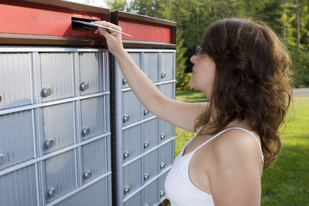 mailing: Woman mailing a letter
