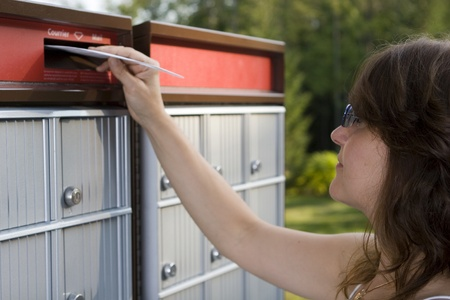 Woman mailing a letter Stock Photo - 10516800