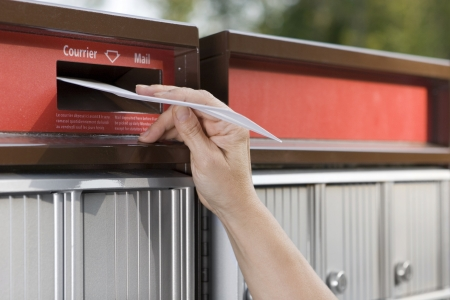red post box: Mailing a letter (hand)