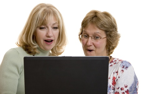 impressed: Impressed women looking at computer screen