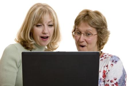 euphoric: Impressed women looking at computer screen