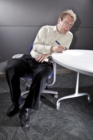 Businessman taking notes  photo
