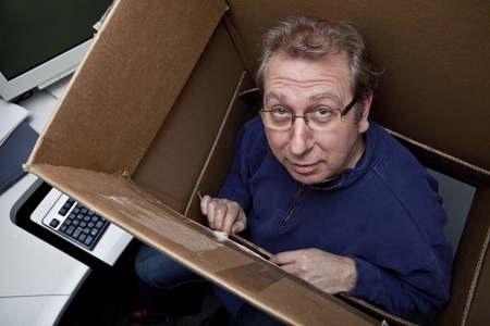 Businessman thinking inside the box  photo