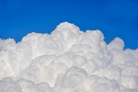 Puffy clouds and blue sky  Stock Photo