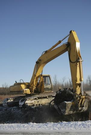 Excavator in action winter  Banco de Imagens
