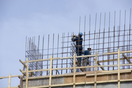rebar: Construction workers securing rebar