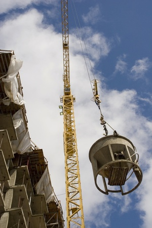 Construction crane in action  Banco de Imagens