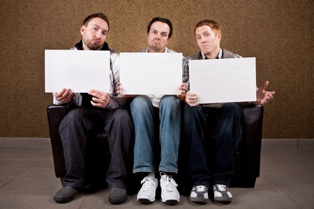 young add: Unimpressed Judges with blank signs Stock Photo