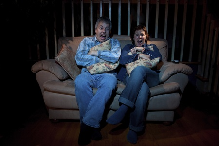 Couple watching scary movie on TV  photo