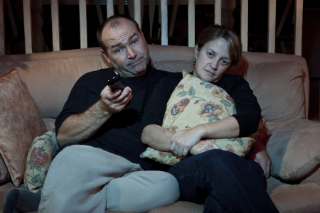 bored man: Bored couple watching TV  Stock Photo