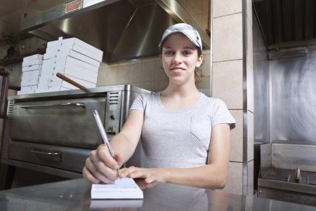 Waitress taking order in a fast food restaurant Stock Photo - 10522526