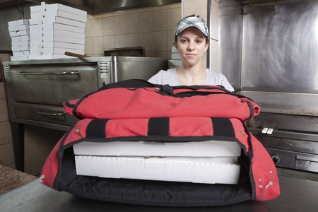 take out: Waitress with take out pizza in a thermal bag  Stock Photo