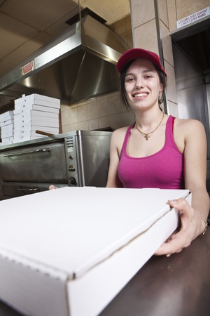 take out: Waitress with take out pizza  Stock Photo