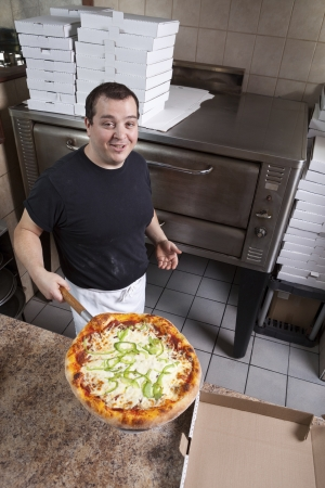 Chef with fresh take out pizza