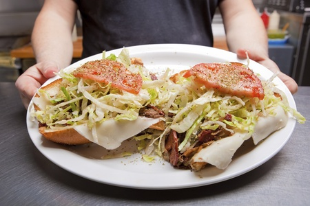 high calorie foods: Hoagie Open Faced Submarine Sandwich on a plate